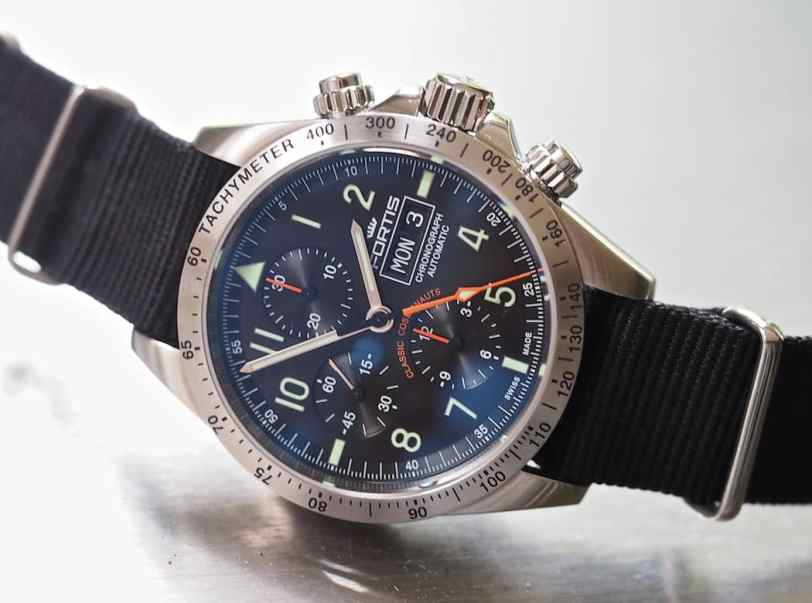 The orange on the dial of the Fortis Classic Cosmonauts adds great contrast as well as the green indices