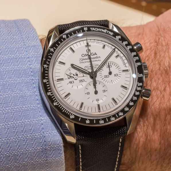 Wristshot of the Omega Speedmaster Professional Silver Snoopy Award