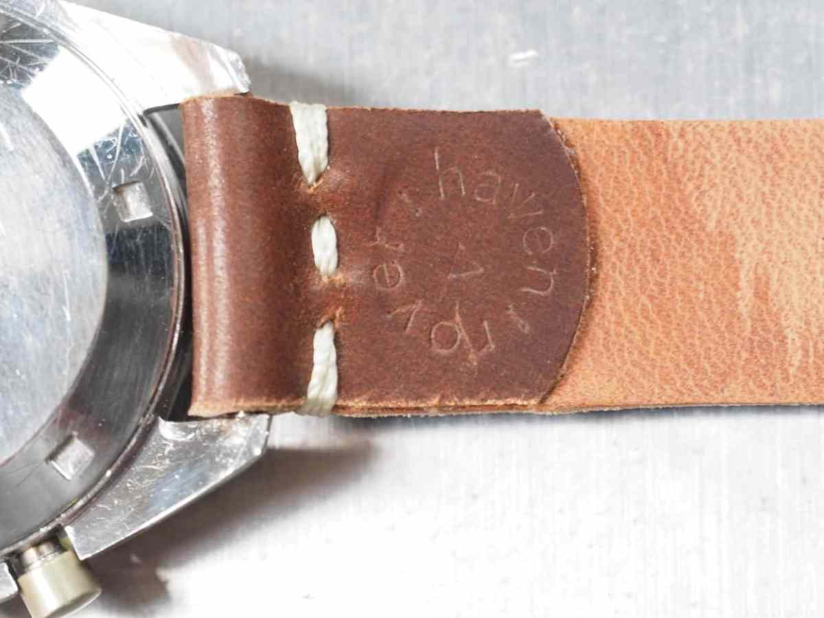 The backside of a saddle stitched strap from Rover Haven with the brand's logo