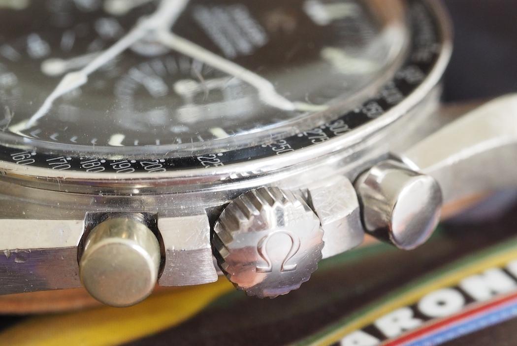 An original crown on an Omega Speedmaster 145.012