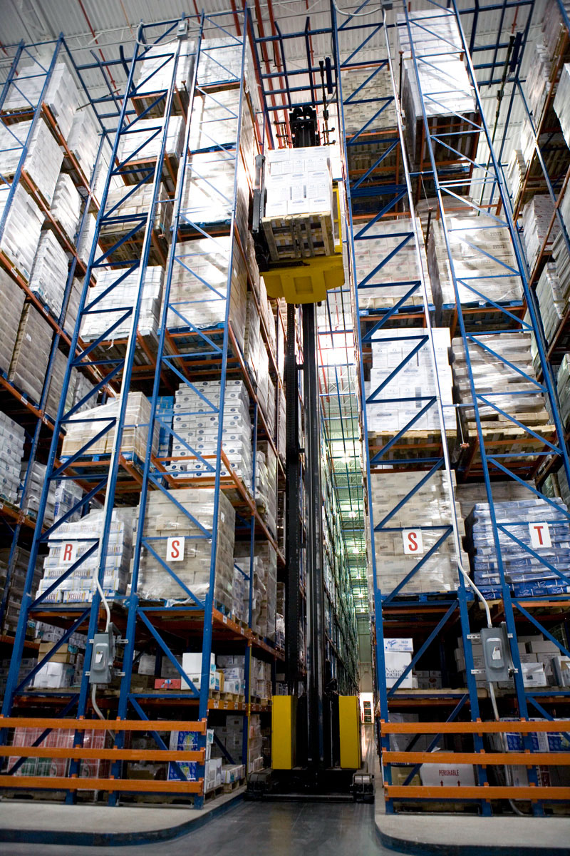 A swing reach truck picks product from Frazier's Sentinel Selective Pallet Rack in a refrigerated warehouse.