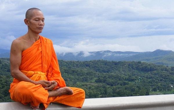 Buddhist Monk on ledge