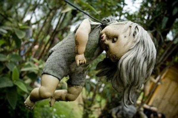 doll-hanging-on-tree