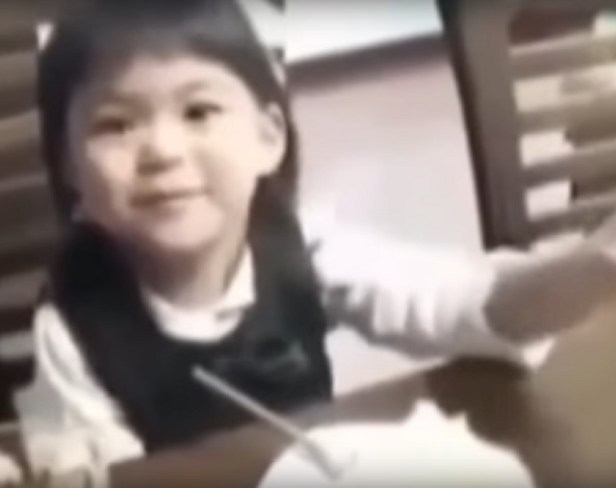 young Japanese girl points to dead uncle ghost