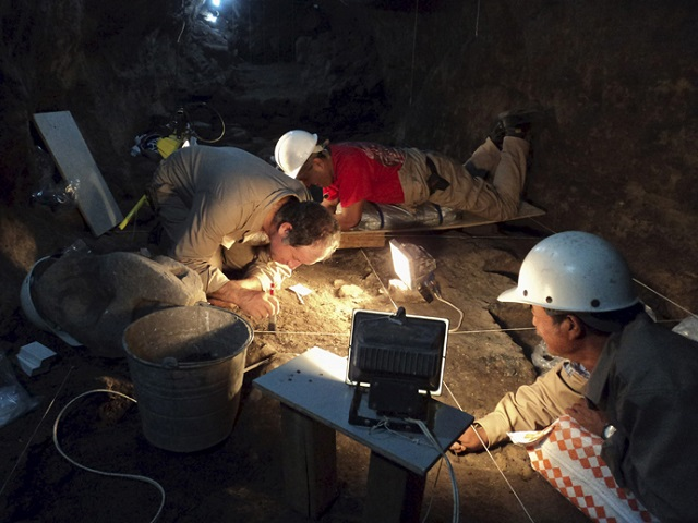 Archaeologists underground in the Pyramid of the Moon