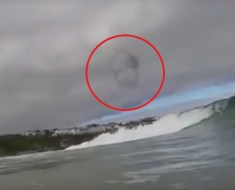 Surfer recording UFO in sky