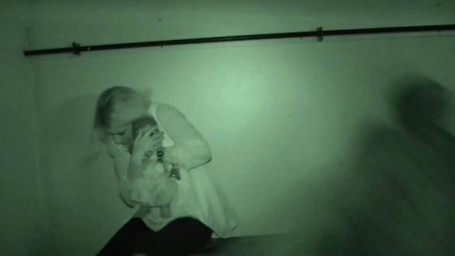 Rebecca Palmer ghost hunter with doll UK