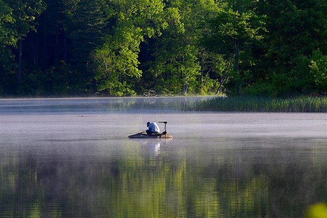 fisherman on lake