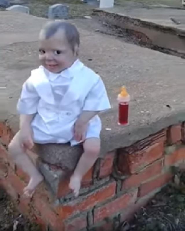 baby vampire doll graveyard evening