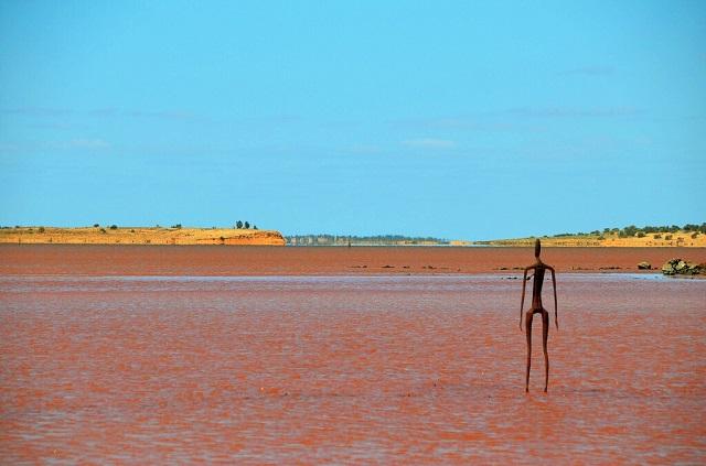 Statues stand in Australian Lake