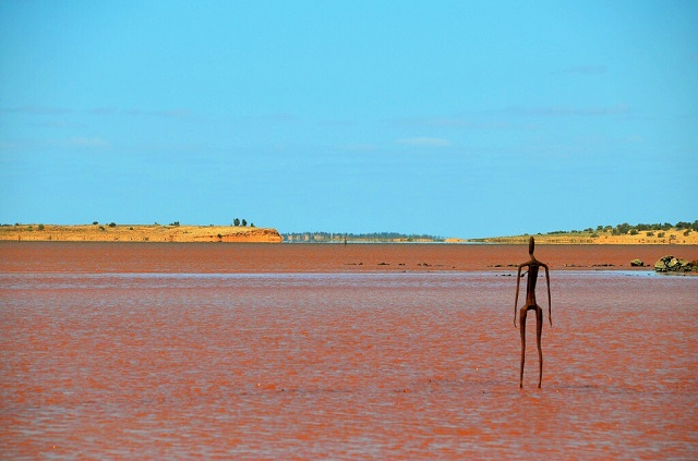 Statues stand in Australian Lake