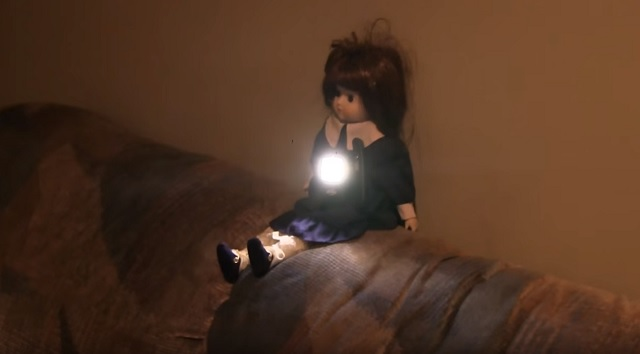 Haunted doll moves on sofa