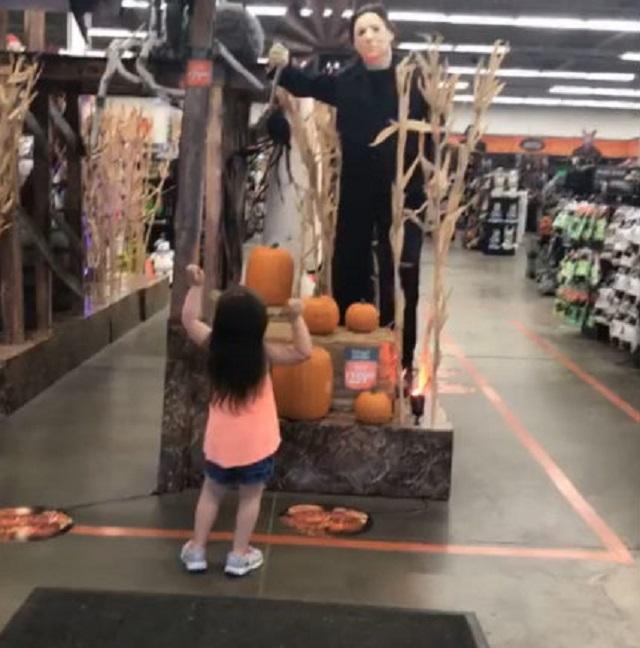 Little Girl Dances With Mike Myers Halloween display