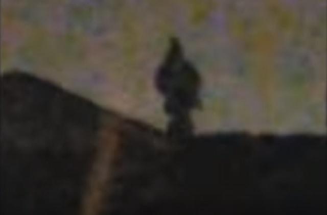 Descending Dark Humanoid Figure Filmed