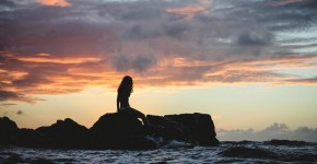 Mermaid-on-rocks-by-the-shore