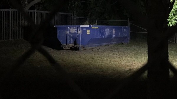 dumpster at night