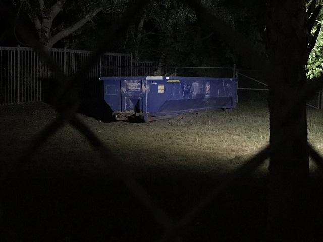 dumpster at night