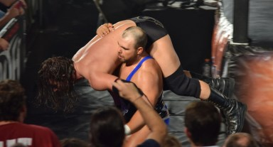 Elgin carrying his victim to the guardrail...