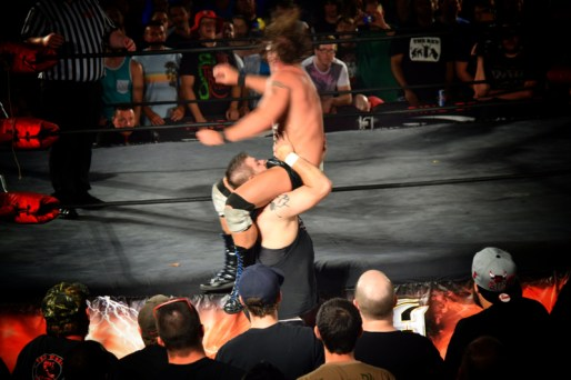 Steen attempted a powerbomb on the apron, but Silas caught the ropes.