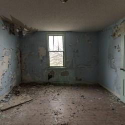 Behind the green door of an abandoned bedroom