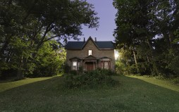 A vacant heritage home in Hamilton, Ontario captured under a full moon