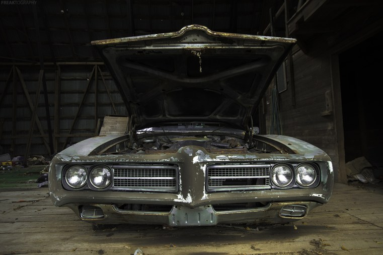 An abandoned car found in the barn of an old derelct house in Ontario Canada.