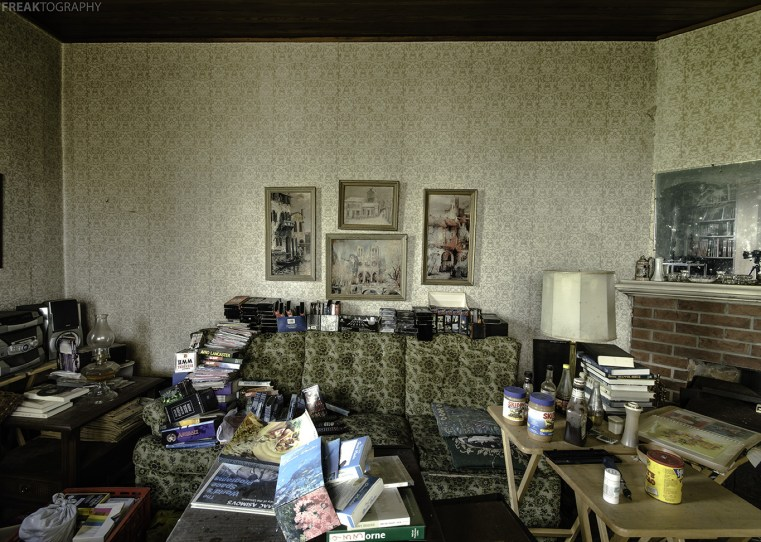 A very messy Living Room in an Abandoned House in Ontario.  This home seemed to have been lived in by a hoarder.