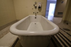 A bathtub in the geriatric ward of a a vacant psychiatric hospital.