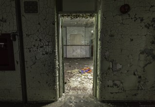 The door way into a mystery room inside an abandoned insane asylum.