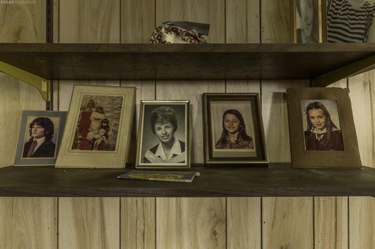Family Photos on a shelf found inside an abandoned ontario house.