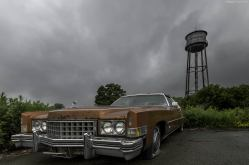 An abandoned cadillac in a small town in New York State