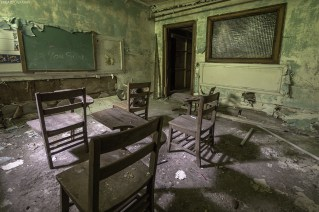 In the basement of an abandoned church in Buffalo sits this old and decaying classroom.