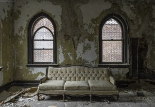 An old couch in an abandoned church in Buffalo, NY.
