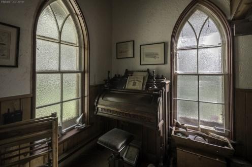 An antique pump organ inside an abandoned Ontario House