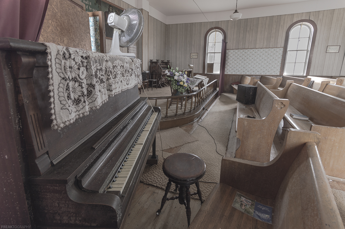 a piano in an abandoned church by freaktography