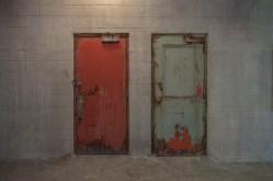 Urban exploration photography by photographer and urban explorer Freaktography, Freaktography, abandoned, abandoned photography, abandoned places, cement, creepy, decay, derelict, door, doors, green door, haunted, haunted places, industrial, photography, red door, two doors, urban exploration, urban exploration photography, urban explorer, urban exploring