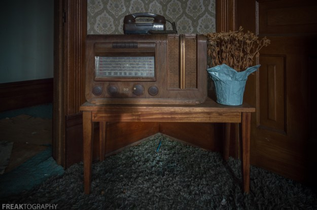 Freaktography, abandoned, abandoned photography, abandoned places, creepy, dead flowers, decay, derelict, haunted, haunted places, old dial radio, photography, radio, shag carpet, table, urban exploration, urban exploration photography, urban explorer, urban exploring