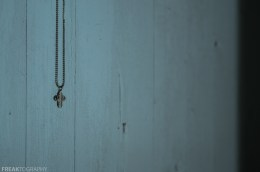 Freaktography, abandoned, abandoned photography, abandoned places, blue, creepy, cross, decay, derelict, haunted, haunted places, minimalism, necklace, photography, urban exploration, urban exploration photography, urban explorer, urban exploring
