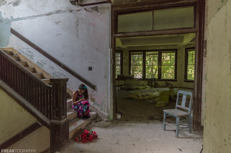 CHILD, DRESS, ELEGANCE IN ABANDONMENT, Freaktography, INNOCENT, MODEL, PORTRAITS, POSING, PRETTY, abandoned, abandoned photography, abandoned places, chair, creepy, dead flowers, decay, derelict, flowers, girl, haunted, haunted places, photography, portrait, stairs, sweet, urban exploration, urban exploration photography, urban explorer, urban exploring