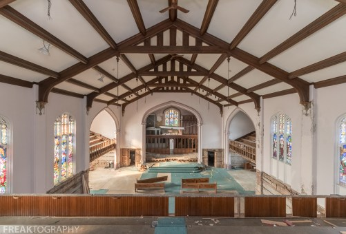 Wide angle urban exploration photograph of an abandoned church