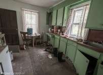Bright green kitchen in the perfectly preserved abandoned time capsule house. Urban Exploring Gallery of a Perfectly Preserved Abandoned Time Capsule House in Ontario, Canada by Freaktography. Canadian Urban Exploration Photographer