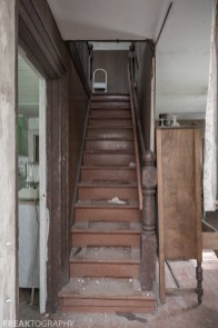 Stairway in the perfectly preserved abandoned time capsule house. Urban Exploring Gallery of a Perfectly Preserved Abandoned Time Capsule House in Ontario, Canada by Freaktography. Canadian Urban Exploration Photographer