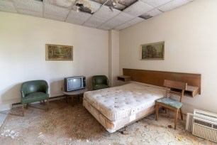 abandoned 1980s hotel bed