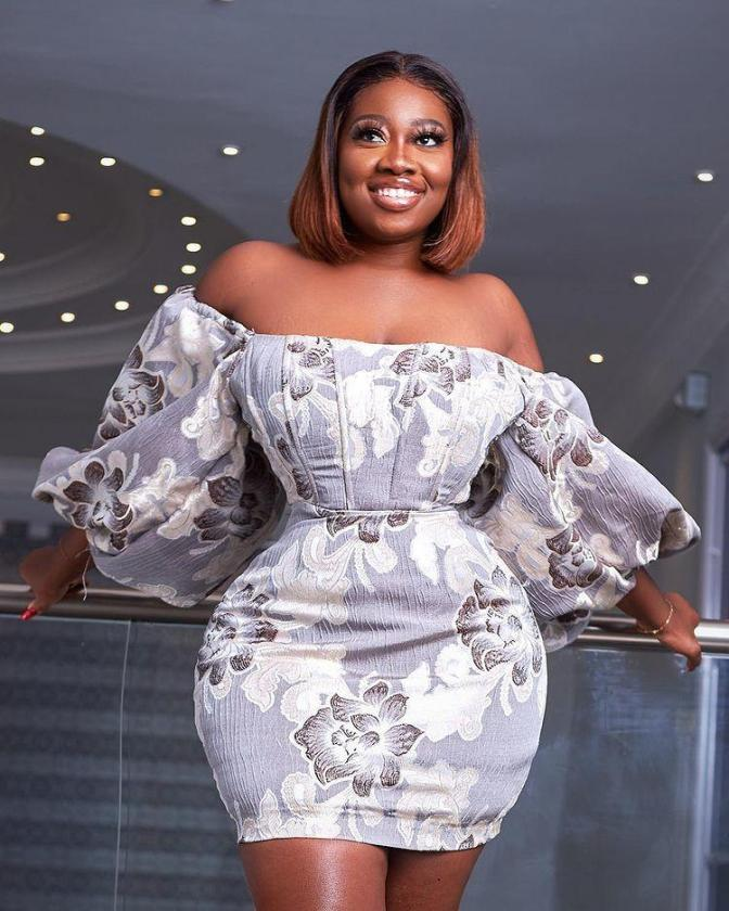 , Shugatiti takes over social media with photos clad in a white dress, Frederick Nuetei