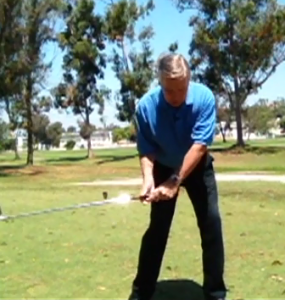 Hitting a golf ball low you need to fall down to take the loft off the club