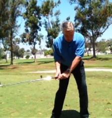 hit a golf ball low