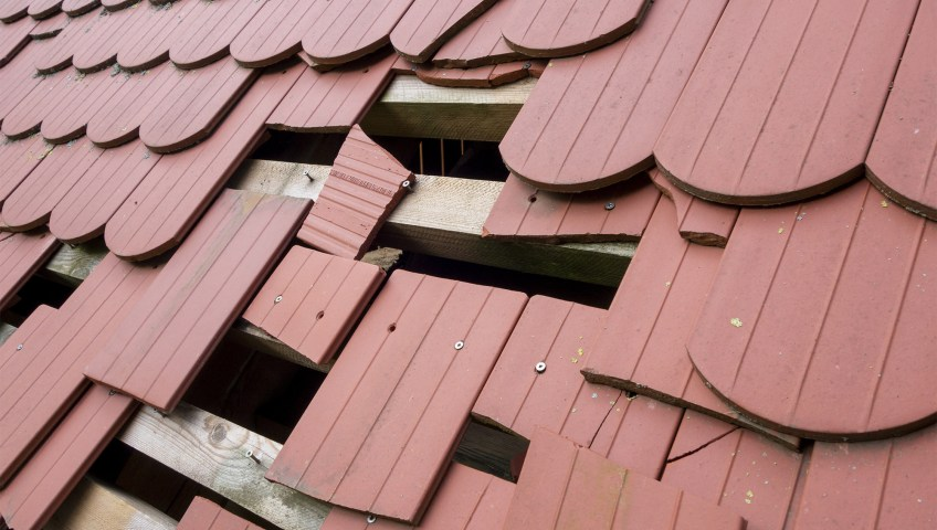 A roofing surface in need of a partial roof replacement