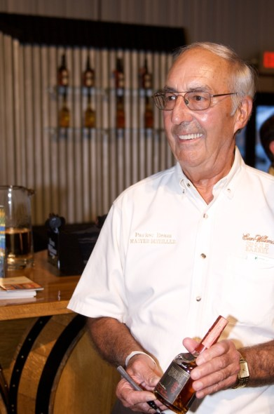 Parker Beam signing whiskey bottles at the 2011 Bourbon Festival in Bardstown, Ky. Mr. Beam is the master distiller for Heaven Hill Distilleries. He was diagnosed with ALS in 2010, but announced the illness to his fans in 2013.