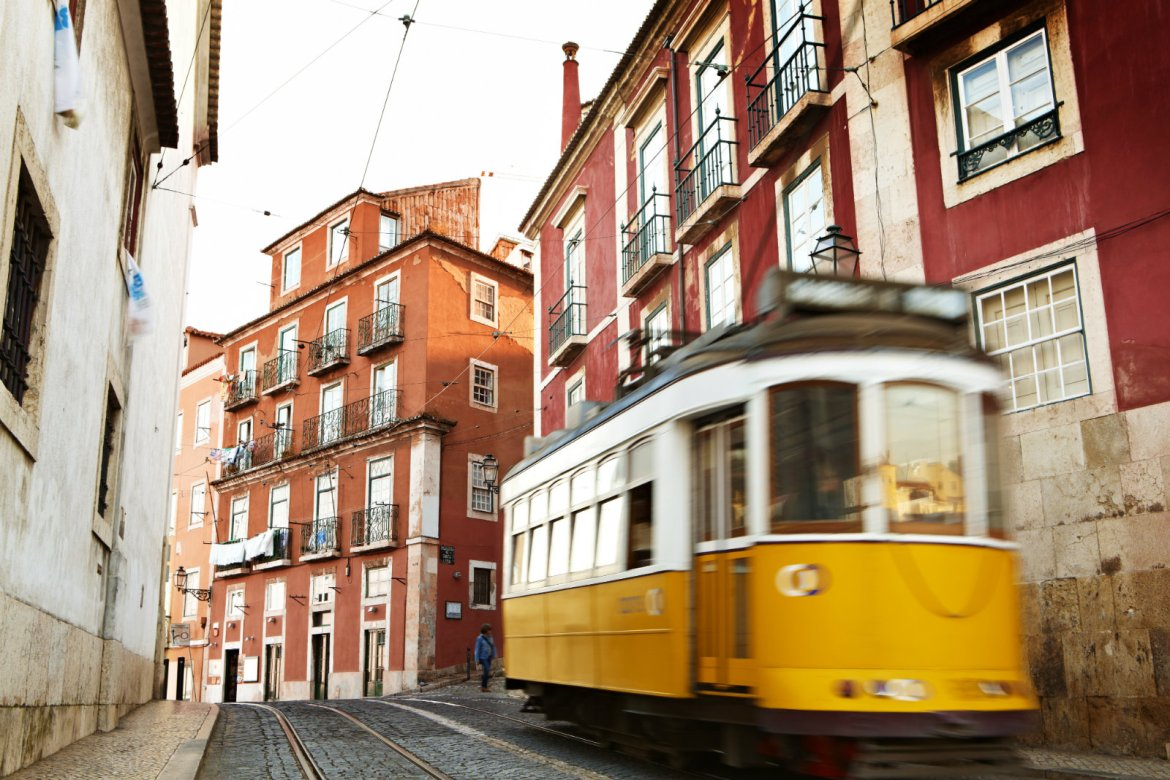 the-number-28-tram-passing-through-historic-alfama-district-matt-munro-lonely-planet-61333051d86a-2