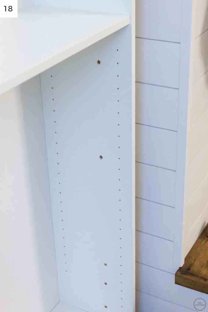 an IKEA Billy bookcase is attached to a 2x4 spacer board using several countersink screws